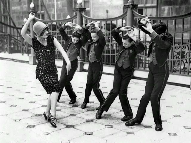 American woman teaching English boys to dance the Charleston. Great Britain, 1925